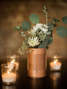 Take an urban approach and incorporate DIY industrial spray painted tin cans for. Take an urban approach and incorporate DIY industrial spray painted tin cans for your wedding centerpieces. Bronze tones are the perfect expression of modern decor! Winter Centerpieces, Simple Wedding Centerpieces, Diy Wedding Decorations, Floral Centerpieces, Centerpiece Ideas, Tin Can Centerpieces, Quinceanera Centerpieces, Diy Wedding Tables, Tin Can Wedding Ideas