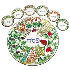 """The Seven Species Hand Painted Glass Seder Plate By Yair Emanuel by Yair Emanual. $155.45. This elegant seder plate is a wonderful way to bring more color to your Pesach table. The plate itself is round glass with beautiful painted motifs of the """"Seven Species of the Land of Israel"""": wheat, barley, grapes, dates, figs, olives, and pomegranates,"""