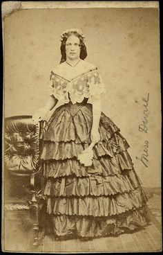 1860's Miss Durie in a multi-flounced ball gown with wide lace trim at the neckline, CDV.