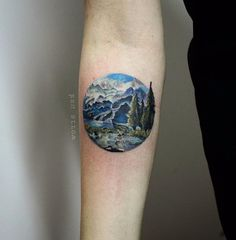 Small-Realistic-Mountains-Scene-In-Circle-Tattoo-On-Forearm.jpg (592×604)