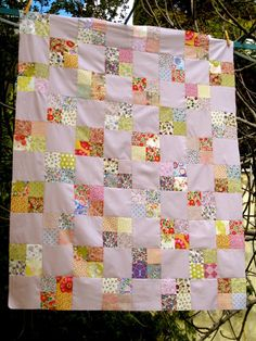 Liberty Four Patch Top by http://quiltingstories.blogspot.com/2015/03/liberty-four-patch-lap-quilt-top-finished.html