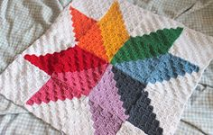 A large motif or afghan block. Measures 52cm squared. Based on the ever popular C2C (corner to corner) style of crochet, and inspired by beautiful patchwork quilts. A great stash buster, and written in US terms - although translating to UK is a simple substitution!