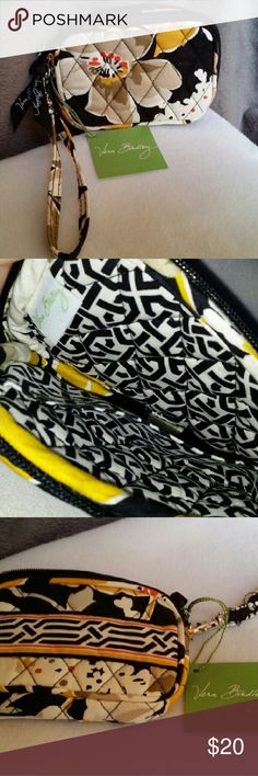 NWT Vera Bradley Card Holder/Wristlet in dogwood Pocket on inside and zips up nice and neat. She's cute and all yours if you want her... Bags Clutches & Wristlets