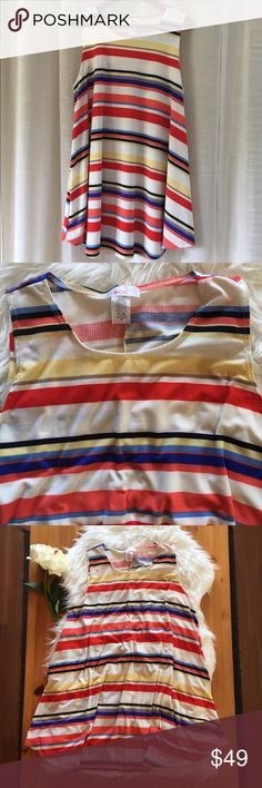 Striped Tank Dress Fun, flowy, and super comfy. This casual, lightweight dress is perfect for summer! Made in the USA. Soft and stretchy rayon/polyester/spandex blend. Brand new! Never worn. moa Dresses Mini