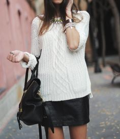 Chunky sweater and leather skirt combo for fall.  Must have! Check the blog for our take on it!
