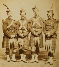 Here are some members of the 79th NY in 1872. Note that half are wearing the distinctive unique 79th NY two-row diced prewar/wartime Glengarries, half the postwar 93rd Highlanders glengarries.   Only the fellow on the far right is wearing the prewar 1858-1861 style sporran.