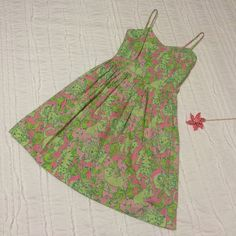 """*RARE* Lilly Pulitzer Dress Hard to find Lilly sun dress in """"Fried Catfish"""" print which features lions, tigers and fish. Pink background with green print and a nice pink lining (non-itchy!) that creates a fuller skirt. Spaghetti straps, knee length, with a slight v-neckline. Back zip. Darting in the bust area helps to keep the girls looking great! Not new with tags, however it's never been worn and is in perfect condition. Lilly Pulitzer Dresses Midi"""