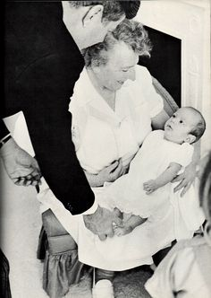 1961. By Mark SHAW. President Kennedy photographed in the White House Nursery. The President, dressed to make a speech, stopped to play with John-John.  Mrs. Maud Shaw, the proud nanny. Caroline, pleased to have her father there, kept playing around and finally the President scooped up John-John with a big hug and a little dance