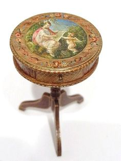 """A small one-drawer table featuring exquisite hand-painted details on all surfaces, table crafted by A. Thede and painted by Natasha in 1984. 2.5"""" H, 2"""" W."""