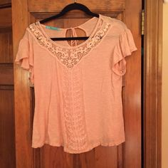 Flowy Peach Shirt with Lace Front Cap sleeved peach shirt with lace front and tie key hole back. In good condition! Tops Tees - Short Sleeve