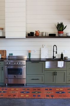 olive green  cabinets BM Tate Olive,warm gray wall color ,French Canvas.The countertops are soapstone and the shelving is reclaimed wood (the same wood used on the stair treads) with a Walnut and Early American mix on the stain.