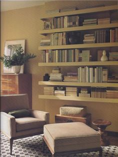Floating shelves for books on front side wall