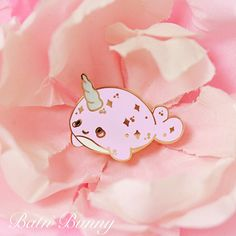 This little cutie patootie is based off Bat n'Bunny original needle felt Kawaii Narwhals. Each pin are gold plated hard enamel with glitter...