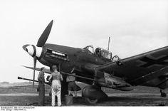German crew servicing a Ju 87 Stuka aircraft, 1942-1944; note 3.7-cm anti-tank guns mounted under wings