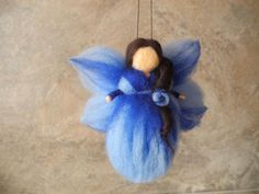 Needle felted angel baby crib mobile elf blue wool fairy baptism fairy gift Christening fairy gift Baby angel blue felted fairy doll  The angel can be a great gift for anyone and it is especially good for baby crib mobiles. You can also use the angel to tell your child Bible stories. A needle felted fairy, in gentle shades of blue. A guardian fairy, and will bring gentle calmness. lovely for a baby room, living room,or bed room.  Size: 11 cm./4,5 inch  NOTE! Only for decoration, NOT for ...