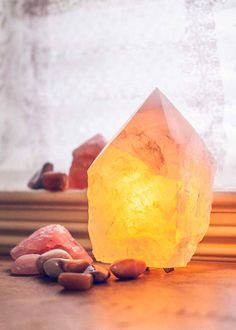 With a loving glow, this lamp lights up any space with a beautiful, romantic warmth. Made with a large rose quartz point, with perfect facets at the top and fitted for a little light bulb, a perfect n