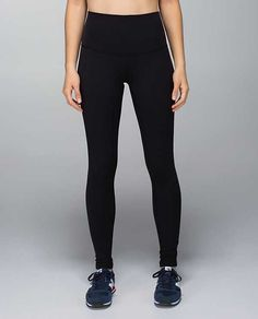 The roll-down Wunder Unders by lululemon replaced all pants for me. In black, with a long top and normal shoes no one will be able to tell they are yoga pants. Most maternity leggings are too thin for my taste or made for the very end stages of pregnancy (so big baggy belly area earlier on). I also found these provide some light lower back support. Buy 2-3 pairs.