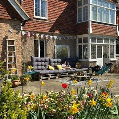 Country house patio with home made diy pallet sofa and cushions from ebay  #sissinghurstlocationhouse #shootlocation #palletsofa #patio Pallet Furniture And Decor, Diy Pallet Sofa, Upcycled Furniture, Courtyard Design, Patio Design, Garden Design, Country House Interior, Country Homes, Decorating Your Home
