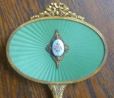 guilloche hand mirror