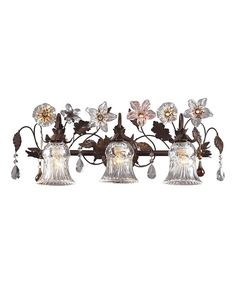 The multiple bulbs of this wall sconce offer brilliant illumination alongside its sleek design featuring ornate scrollwork for an elegant, high-end touch.   California customers, clickfor important Prop 65 information