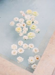 Floating pool flower decor: http://www.stylemepretty.com/2016/06/06/a-sonoma-wedding-inspired-by-old-world-tuscany/ | Photography: Michele Beckwith - http://michelebeckwith.com/