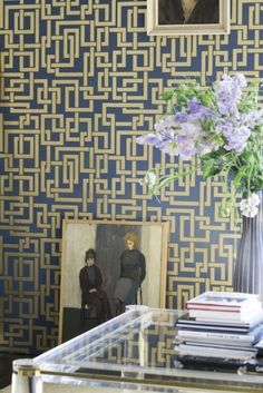 Art form wallpaper is trending this year like this interlocking rectangle wallpaper from Farrow & Ball.