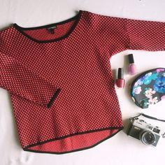 Express Crop Sweater This sweater has three quarter sleeves and a slight high low hem. Red on black. Express Tops