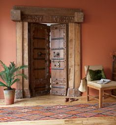 This is a lovely style I like the boldness of the door and how it is popped out by the warmth of the wall. Floor plays it's role too as a nice complement