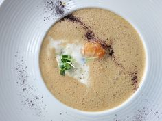 Langoustine Soup with Garlic,marinated Langoustine,White Chocolate & Seaweed at Lava Restaurant in Iceland. Photo by Fiona Chandra. Iceland Naturally http://www.bluelagoon.com/food-and-drink