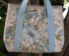 One design, 6 different versions! Each one of a kind! Fabric Cotton Pattern Mixture of pale blue,taupe, and natural patterns, ticking, floral, mini check, stripe Construction Peltex Stabilizer, padding, Interfacing, gingham check cotton lining Pockets 1 outside slip-in 6 x 8 inches 2