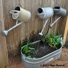 Old watering can fountain