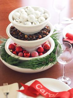 All mixed up-three mixing bowls stacked-to keep them from sitting inside each other-place a cereal bowl upside down between each layer.  Use mini-ornaments, dried pods or nuts, hard candies, greens, and ribbons to create a wonderful centerpiece
