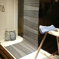 Window display at KITUB in Copenhagen. All textiles by me: handwoven room divider in paperyarn. Totebag in shibori and handwoven scarf, both dyed with indigo!