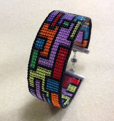 Collage Loom Cuff with Leslie Rogalski Level: All Levels Technique: Basics, Bead Stitching, Loom Seed Bead Patterns, Beading Patterns, Beading Ideas, Beading Supplies, Seed Bead Jewelry, Beaded Jewelry, Jewellery, Bead Loom Designs, Motifs Perler