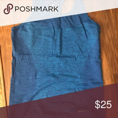 Medium Nike Racerback Tank Medium Blue Nike Racerback Tank. NWOT Never Worn. Great shirt just not my style. Perfect for the gym or working out. Nike Tops Tank Tops