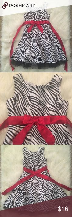 Girl's Zebra Dress This is a super cute fancy zebra dress. It is a girl's size 6, but I'm not sure of the brand because my daughter cut the tag out. Still in perfect condition, she only wore it once. Has a lining underneath with tulle at the bottom, and a zipper and red satin tie at the back. Perfect for special occasions or holidays! Dresses Formal