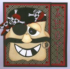 "Pirate head inspiration: Rae Harper-Wild West Paper Arts. Recipe: SUPapers: Black cs-base, RealRed. DCWV LaCrème Stk. SUInk: BrntBrown Sugar-distress, B.Gray-verse distress. Die: SU/Sizzix TopNote-head/mustache. SUPunches: 1/2"" circle-earring hole, 3/4"" circle-pupil/earring, 1-3/8"" circle-eyeball/eyelid/patch), 2-1/2"" circle-mouth/teeth), 2"" Ex.Lrg. Oval-ears, Owl Punch-nose. Scarf/Tails: Handdrawn/cut.  Sizzix WingoZingo Alpha Sizzilit.  SU ChalkMarker. SU Daz.Details-letters."