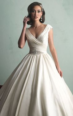 The Allure Bridal 9155. Incredibly romantic and beautiful, this gown would be perfect for a dramatic wedding!