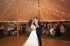 Reception decor: Sailcloth tent with bistro string lighting, natural wood and ivory.