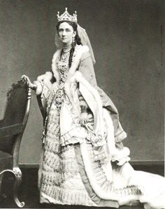 Queen Louise of Denmark, 1817-1898, nee Louise of Hesse-Cassel.  Grandmother of Europe. Wife of Christian IX, they had 6 children:   Frederick VIII of Denmark, father of Christian X, and Haakon VII of Norway; Queen Alexandra, mother of George V, and Maud, Queen of Norway; George I of Greece, father of Constantine I; Dagmar (Marie Feordorovna) of Russia, mother of Tsar Nicholas II; Thyra, Crown Princess of Hanover and Duchess of Brunswick; and Prince Valdemar.  They had 39 grandchildren.