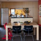 McMinn and Janzen's kitchen opens onto a double-height living and dining area.  Photo by Lorne Bridgman.