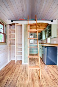 Colorful all wood interior provides a unique look in this tiny house.