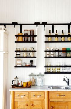 Perk up your morning routine with a home coffee station. These clever beverage hubs hold all the fixings for your cup of joe in one convenient spot. Use inspiration from these stylish and highly functional kitchen coffee stations to create your own at-home java spot. #coffeebar #diycoffeebar #athomecoffeestation #coffeebarideas #decor #bhg
