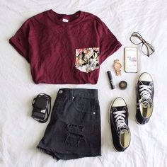 12. Maroon T with a floral print pocket, ripped black jean shorts, high top All-Stars, and clear wide rimmed glasses