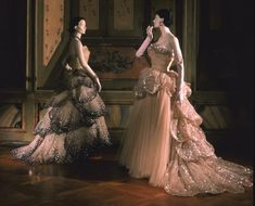 Christian Dior (French, 1905–1957). Left: Ballgown (Venus), 1949. Silk tulle embroidered with paillettes, pearls, and rhinestones; silk inner skirt; horsehair stiffening. Gift of I. Magnin & Company.     Interesting block post about the gowns and how the museum acquired them: http://deyoung.famsf.org/blog/framework-juno-ballgown-christian-dior#