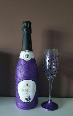 Purple glitter bottle and glass