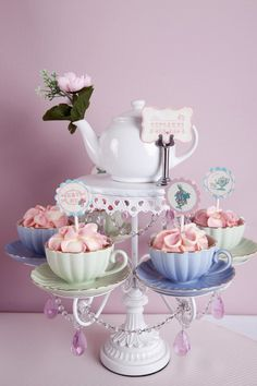 Cupcakes in teacups for an Alice in Wonderland! So clever! - You could put a cupcake or cookies in each of the teacups!