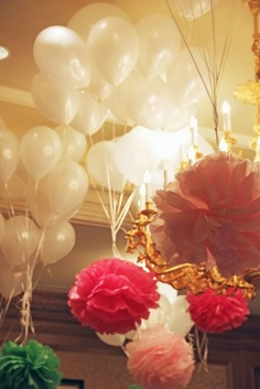 paper flowers tied to the balloons, and floating. so pretty