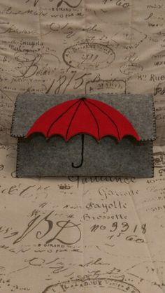 Umbrella felt clutch wallet, could also work as book coverAdorable grey felted clutch purse with red umbrella motif Love the umbrella idea.This Pin was discovered by GorThis is a cute idea that could easily be DIY or just add a little fun in an outfi Felt Wallet, Felt Clutch, Felt Purse, Clutch Purse, Diy Wallet, Purse Wallet, Pouch, Felt Crafts, Diy And Crafts