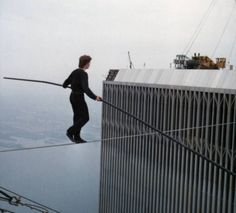On Aug 7, 1974 Frenchman Philippe Petit(an illegal street juggler,pickpocket, poet and the grandest tightrope walker) walked a tightrope strung between the twin towers of New York's World Trade C…